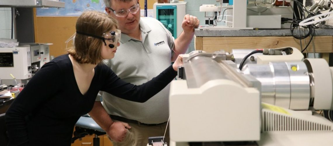 CAL owner and president Mike Goodrich '92 assists as biochemistry major Madison Davis '19 watches a sample enter the spray chamber of the LC-MS system donated to MC by Adsorptions Systems through this agreement with CAL.